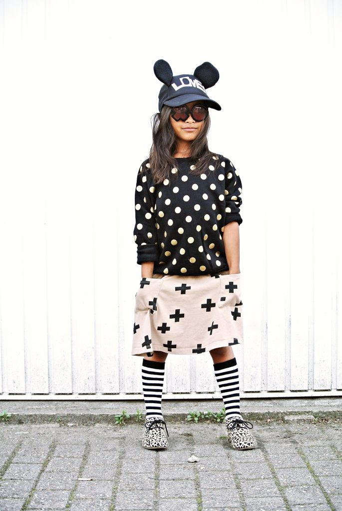 black and white polka dot sweater with blush and black skirt and knee high socks
