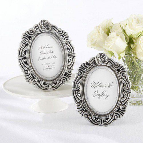 For a vintage wedding, this Work of Art Antique-Finish Place Card Holder/Photo Frame would be perfect to escort your guests to their tables and would make a lovely favor!