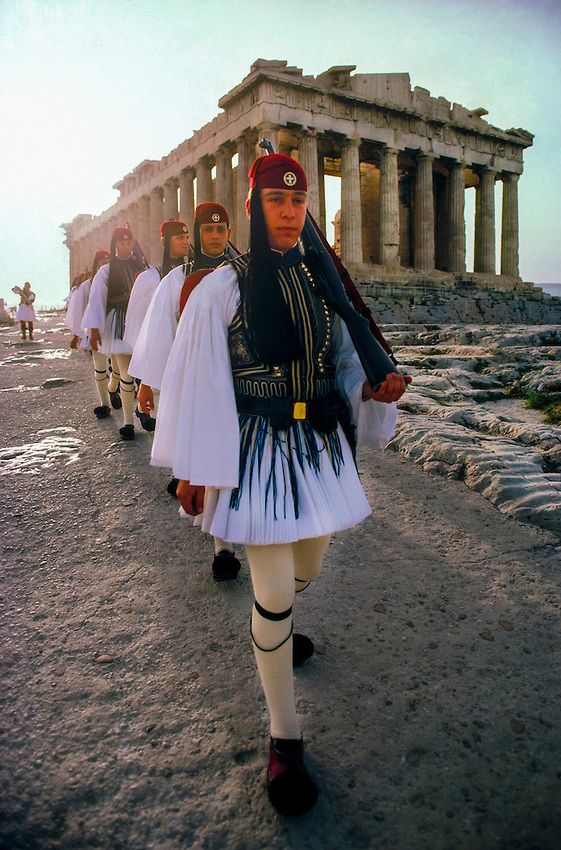 Evzones march past the Parthenon