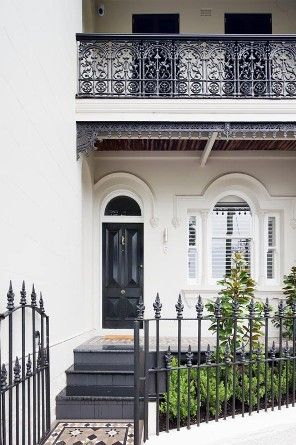 T01 Architecture Paddington white and black terrace house Sydney, iron fence, lace wrought iron black front door