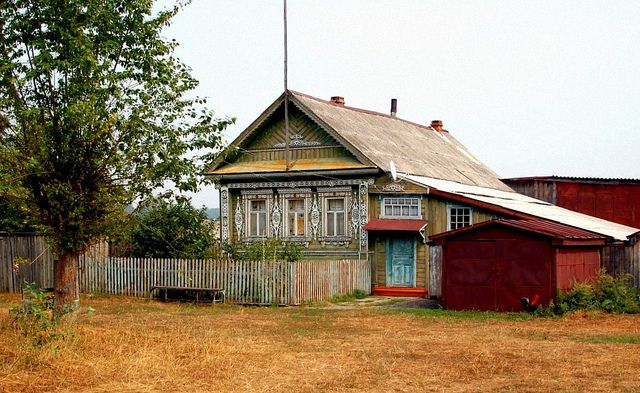 Dacha - Russian country (summer)house.  Some of these are not much more than shacks, but they don't need heat, and everyone that can gets away for a while.