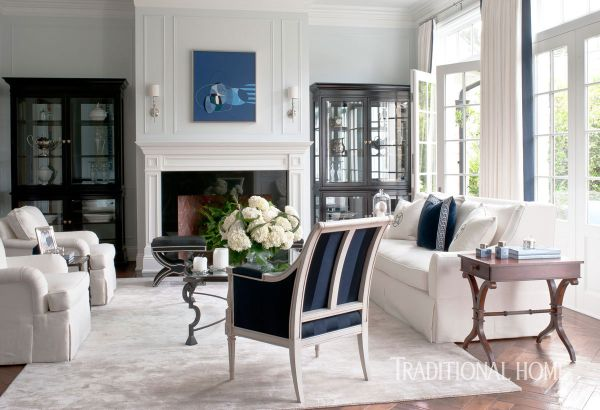 Creamy White Furnishings And Navy Accents Set The Tone In Formal Living Room Where