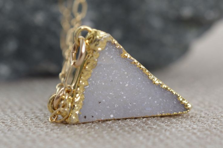 A personal favorite from my Etsy shop https://www.etsy.com/listing/227573444/druzy-triangle-necklace-gold-fill-modern