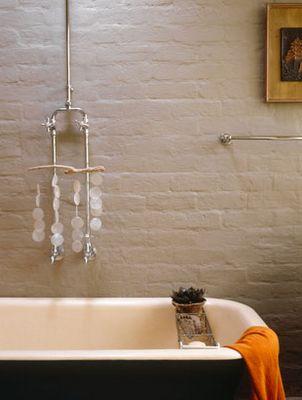 Painted brick exposed plumbing.