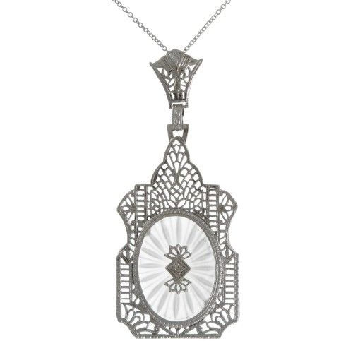 An Art Deco carved rock crystal pendant, 14ct white gold filigree and a diamond set to the center.  Circa 1930s #Rutherford #Melbourne