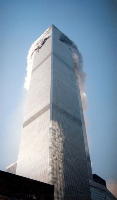 Interesting picture of how the smoke was billowing out of the building just before the flames came out. This picture must have been taken just a second before. 9/11