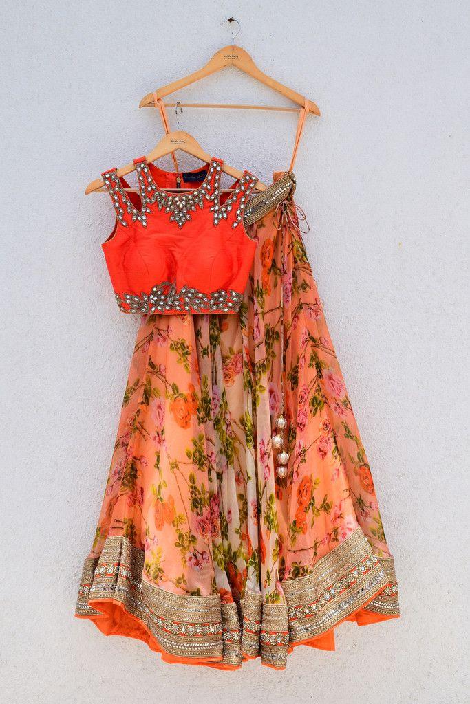 Floral printed lehenga with orange cutwork blouse