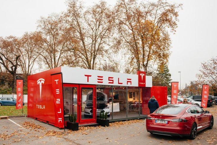 Tesla Motors Inc (NASDAQ:TSLA), Car, Showroom, Customer, Logo, Automotive, Brand, Shop, Sales, Building,