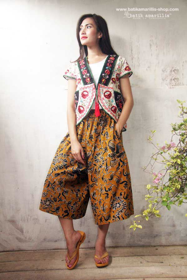 Batik Amarillis's Garden Vest This is when Indonesia's traditional textile :Tenun Batik Gedog Tuban meets Hungarian embroidery This beautiful craftmanship features hand made tassel,pockets plus our signature Arcana in the back.