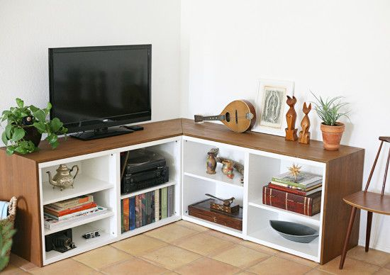 two ikea besta bookshelves in a corner with a piece of high quality plywood encasing them.