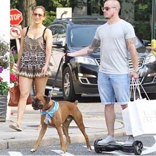 Jennifer Lopez and her boyfriend walking the dog with the scooter board. Shop one now www.bravearscooters.com