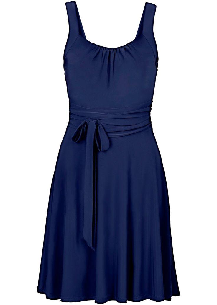 Piękna sukienka koktajlowa z marszczeniami w dekolcie i wiązanym paskiem w…