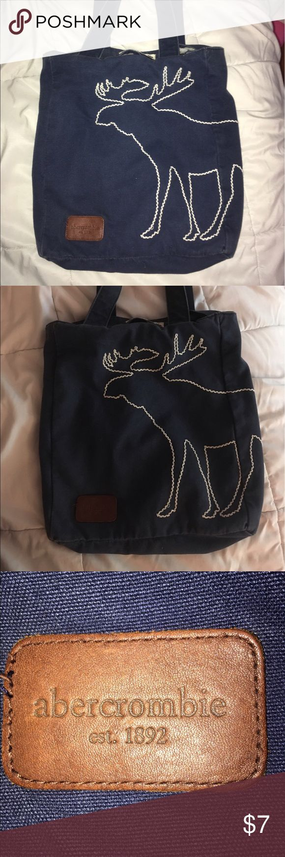 Abercrombie moose tote bag Color is a lil faded but it doesn't look bad. Gives it a vintage look. Cute bag, good for school or the beach. The inside seam flips open and exposes loose threads. But it is not noticeable unless you open the seam (pic 4). Abercrombie & Fitch Bags Totes