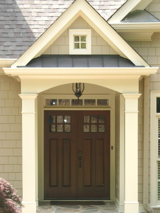 Portico with a combination of materials - wood, metal, stone, cedar shakes and metal.