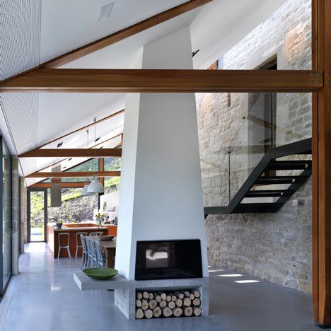 Threefold Architects of London converted a set of Grade II-listed warehouses into a family home just outside Bath, England