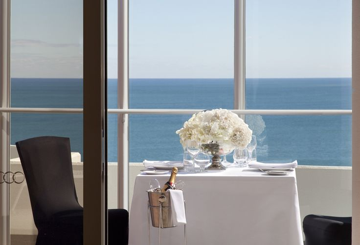 Romantic dining setting on the balcony of Rendezvous Hotel Scarborough,
