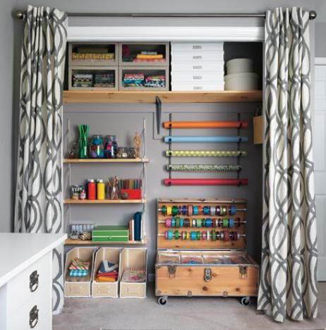 You might like the look of an outset closet curtain rod. Covers the door frame, less noticeable and can push past door opening for easier access. Craft room!!