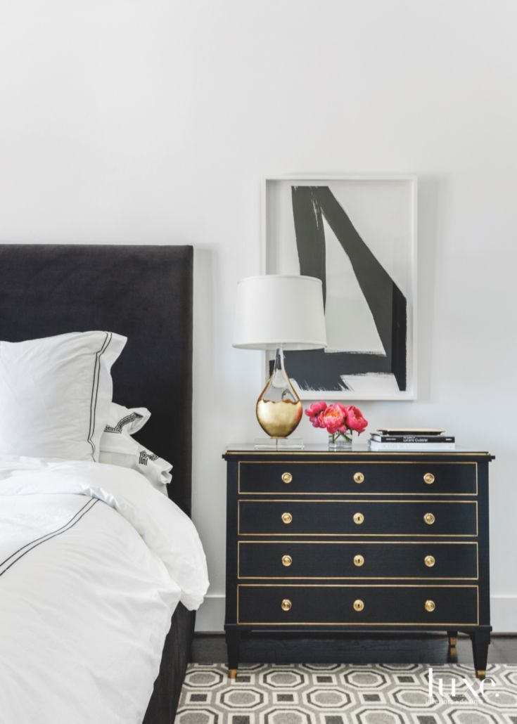 High Contrast Bedroom With Black And White Abstract Art Upholstered Bed Neoclassical Bedside Chest