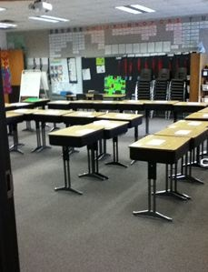 "I position the desks in two formations. I have an outer ""U"" block with sides of 6, 6,6, and a smaller ""U"" block on the inside of 2, 4, 2. When we meet we can easily move the inner desks back to the outer desks. This allows me to have a nice-sized open space in the front of the classroom where the students can sit on the floor for our ""gathering place."" It also allows students to work at their desks when they will be doing ""read to self, word work, or working on writing."""
