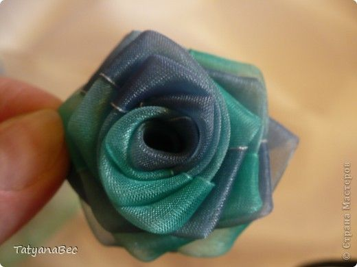 "There are many creative ways to sew beautiful fabric flowers. I have featured quite a lot on my site. If you are interested, you can search for them using the key word ""ribbon"". Here is another DIY tutorial to show you how to make chiffon ribbon rosettes. They are so pretty! You can …"