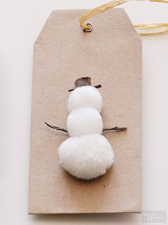 Create a wintry symbol on a basic gift tag in the familiar shape of a snowman. Stack fuzzy white pom-poms to form the body, and find twigs to make a hat and arms fit for Frosty./