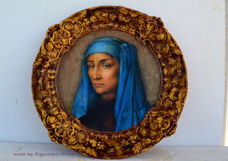 wooden tray decorated with golden patina and medieval portrait