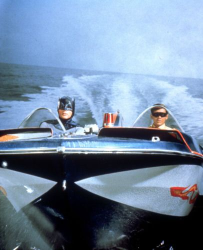 Batman and Robin patrolling Gotham City's waters