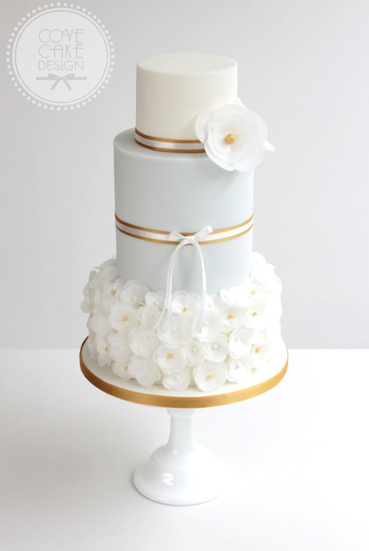 Pale blue and gold wedding cake with wafer paper flowers