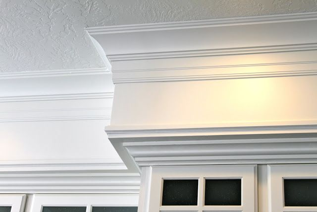3 pieces of trim - crown, a baseboard hung upside down, and pin mold at the bottom of the soffit.