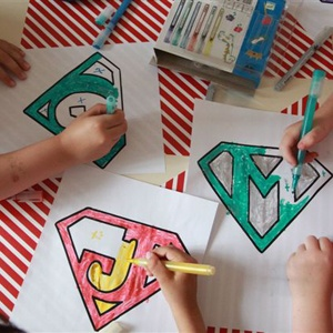 DIY cape - My Superhero Birthday @Niki Lloyd I think we can totally do this, have the kids color their letter, either do it on board paper or I can get white felt from Al anwar and them color with crayons? let me know