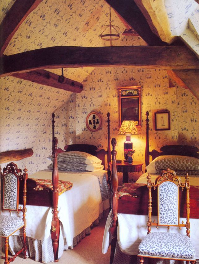 Antique Bedroom Furniture / Beds | Room with blue and white paper and ancient beams