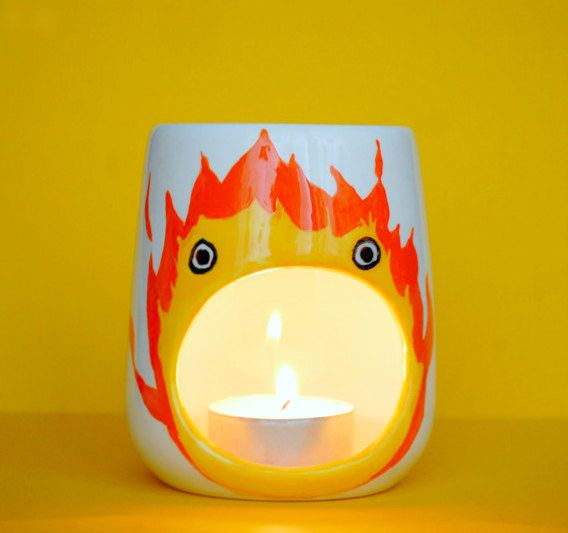 This candle holder that's the most accurate depiction of IRL Calcifer. | 33 Gifts That Any Miyazaki Lover Will Go Nuts Over