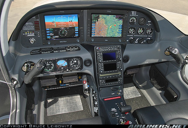 Cirrus SR22 glass cockpit.  A great plane.  I get to fly with Dr. Dhanjani, particularly on Angel Flights.  Alas, there is little for me to do in the right seat other than read back numbers for heading, altitude, air pressure... so most of the time I just nap!