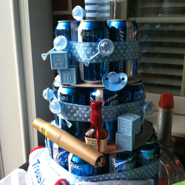 Instead of diaper cake at baby shower- the daddy survival cake!
