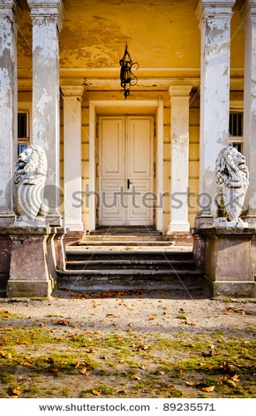 Beautiful palace doors with noble lions figures. Zloty Potok , Poland