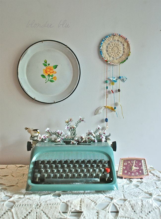 vintage typewriter as a vase for thrifted silk flowers - blondieandco