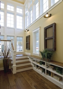 #foyer give this home an open, #fresh-air feeling. Also the use of #built-inshelves add charm, style and function.