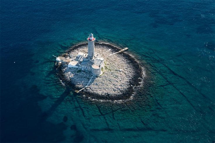 Porer Lighthouse- Croatia. The walk is magnificent due to sunsets on Porer that are considered to be the most beautiful on the Adriatic.