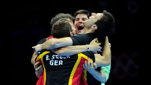 Timo Boll (R), Bastian Steger (2nd L), coach Joerg Rosskopf (L) and Dimitrij Ovtcharov (2nd R) of Germany celebrate Boll defeating Tianyi Jiang of Hong Kong, China and winning the Men's Team Table Tennis bronze medal match on Day 12 of the London 2012 Olympic Games at ExCeL on August 8, 2012 in London, England. (Photo by Michael Regan/Getty Images)