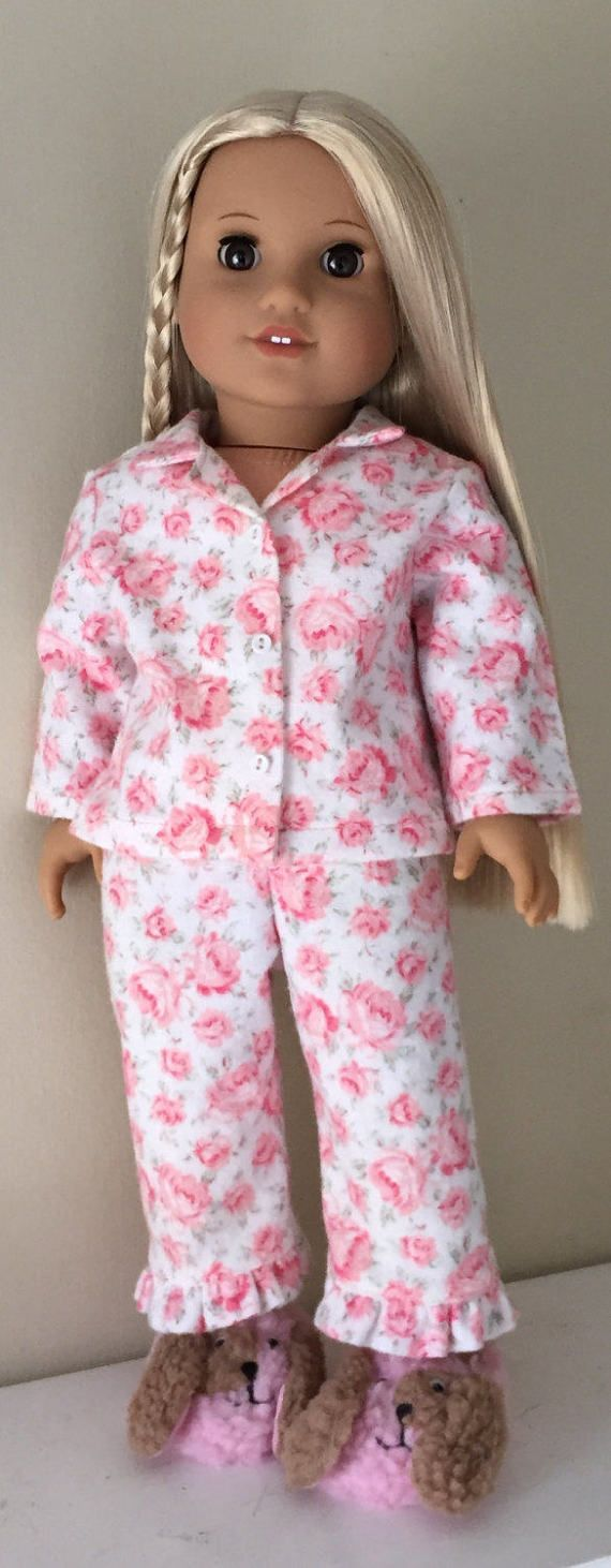 Flannel rose print pajamas by GumbieCatDollClothes on Etsy. Made using a modified version of the Heartwarming Pajamas pattern. Find it at https://www.pixiefaire.com/products/heartwarming-pajamas-18-doll-clothes. #pixiefaire #heartwarmingpajamas