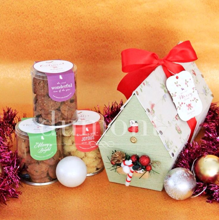 Three jars of our signature home-made cookies in a birdhouse box with detailed christmas ornaments