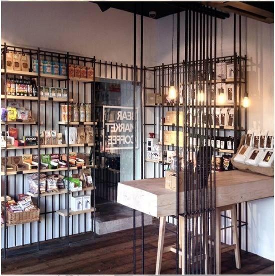 德國VAV建築設計事務所----熊市咖啡館(Bear Market Coffee) 設計上大膽的採用了大量鋼筋作為隔斷、擱架,讓整個咖啡館看上去有著工業粗曠的美感 但是卻也有著德國人專屬的鋼鐵靜謐的美學  from Arthur Wei