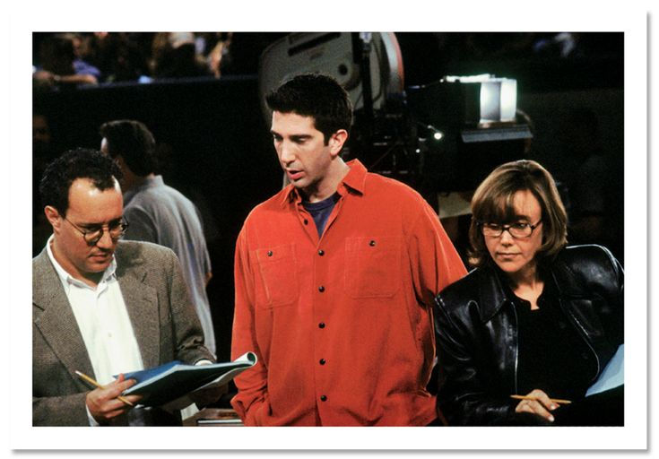 """Executive producer David Crane, actor David Schwimmer (directing this episode), and executive producer Marta Kauffman on the set of a Season Six episode, titled """"The One on the Last Night,"""" in 1999."""