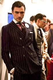 Oh holy Glob, I love a handsome man in a pinstripe suit. Leandro Lima