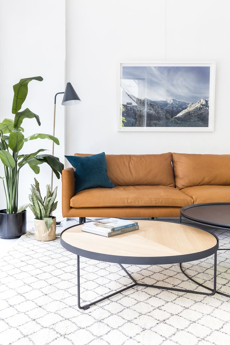 The Louis sofa stands proud and strong in this living space. The hit of incredible Ranchero leather makes the space more dynamic, the neutral Fez Latitude Rug by Armadillo&Co the perfect backdrop. Sia Coffee Table in oak nests with the Freda table, both with slim black powdercoated legs.