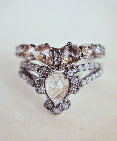 immortalia by maniamania. white gold v-shaped solitaire engagement ring with an 8x6mm pear-shaped, rose cut rutilated quartz, encased by a total of nine 2mm round mix of grey and white diamonds. in other words? omggggggggg.