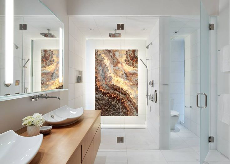 Look at this spectacular accent wall in the shower! #bathroom #design