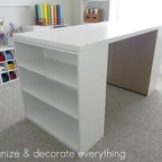 2-$15 Walmart bookshelves plus a painted piece of plywood = a craft table