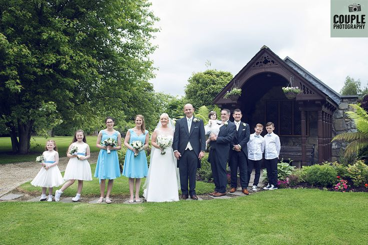 The whole bridal party come outside for a photo. Weddings at The Johnstown Estate, photographed by Couple Photography.