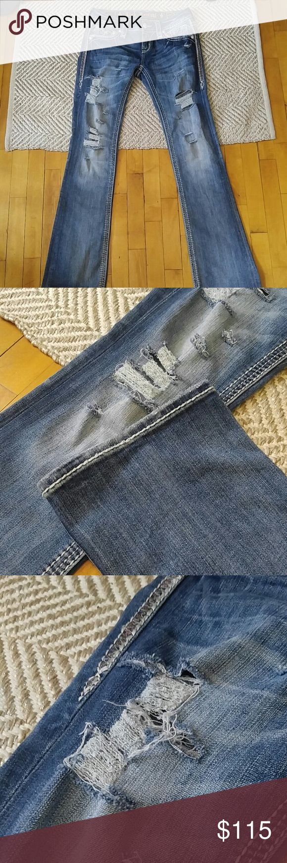Rock Revival Coe Bootcut Waist: 28 Inseam: 33 I CUSTOM distressed these jeans. They originally come with no holes. I have never worn these and they have NOT been washed yet. They are brand new with the tags. They originally go for $160 and I DID pay full price. There is nothing wrong with these❤   ❤Price is FIRM for now❤ Rock Revival Jeans Boot Cut